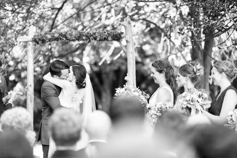 First kiss during Intimate Outdoor Wedding in Vancouver