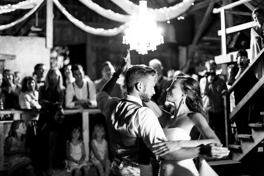 Bride and groom first dance inside a vintage barn