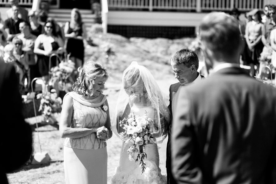 Bride and Groom share tears during an intimate ceremony