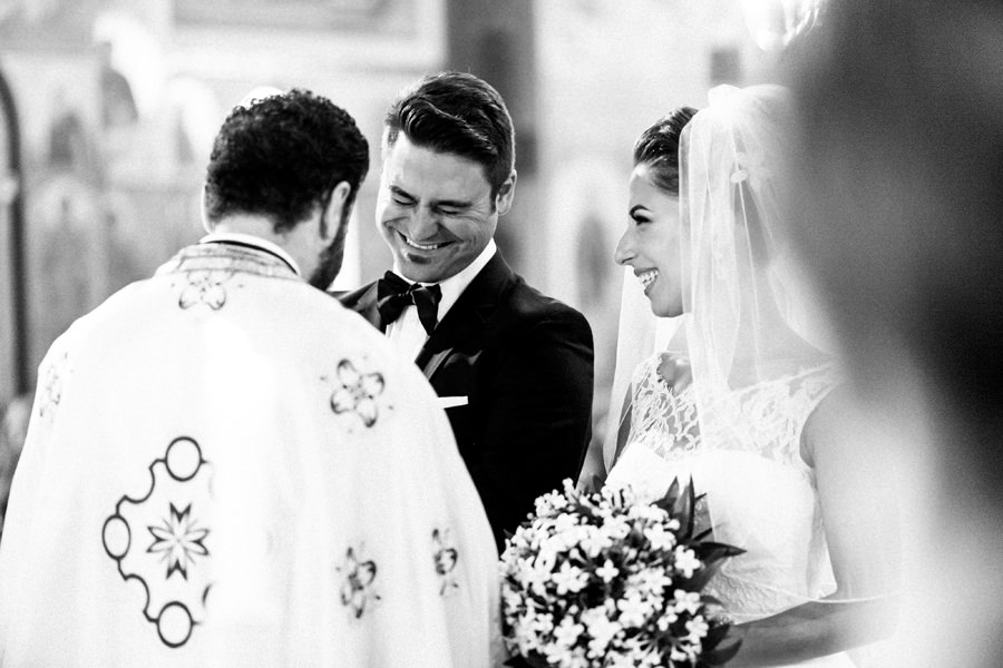 Groom smiles during Greek wedding ceremony