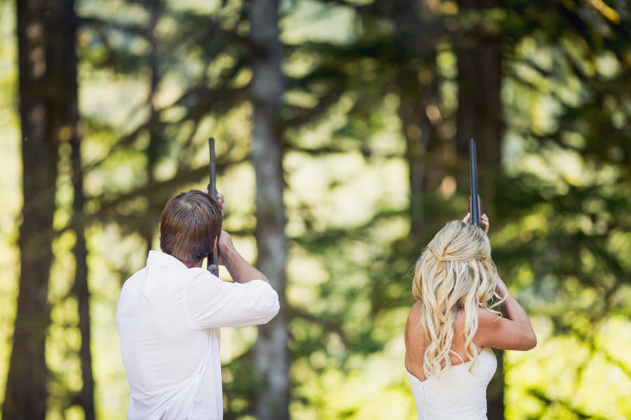 Bride and Groom fire shotguns during ceremony