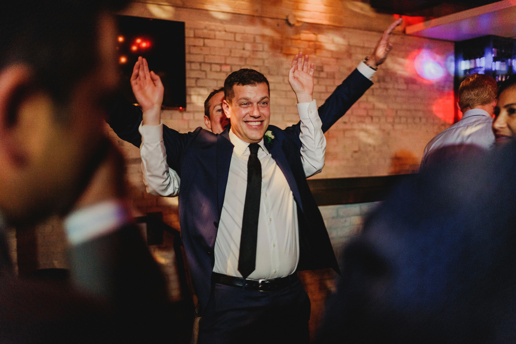 Groom dancing at reception at Brix & Mortar