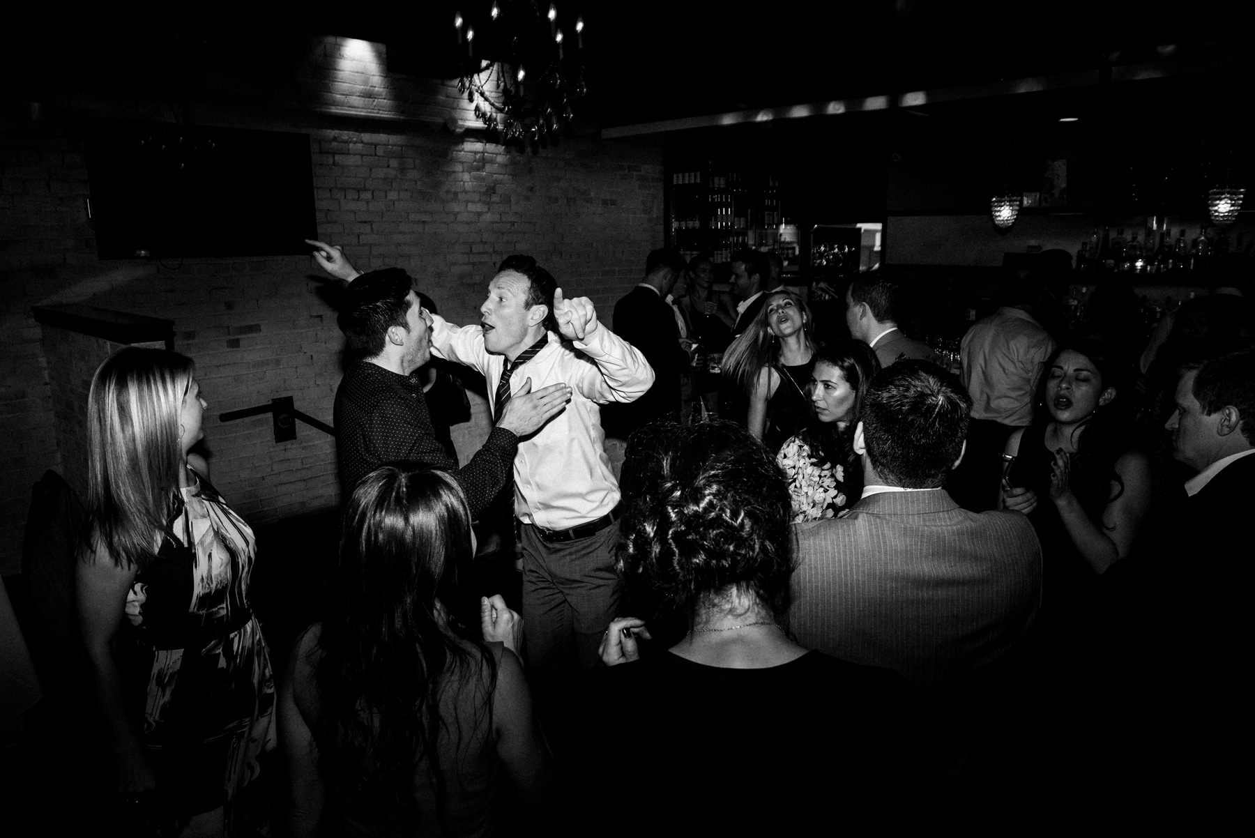 Brix & Mortar Wedding Guests Dancing in Black and White
